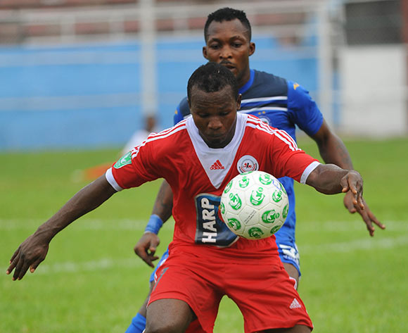 Ejike Uzoenyi of Rangers is challenged by Ugwu Uwadiegwu of Enyimba during the Glo Nigeria Premier League 2014  match between Enyimba and Rangers on March 16, 2014 at Enyimba Stadium, Aba, Abia state
