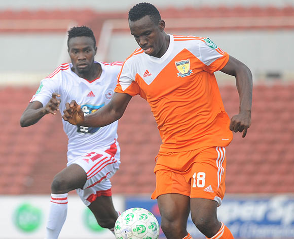 Lukeman Binuyo of Rangers challenges Kingsley Eduwo of Sunshine Stars during the Glo Nigeria Premier League 2014  match between Rangers and Sunshine Stars on April 6, 2014 at Nnamdi Azikiwe Stadium, Enugu, Enugu state