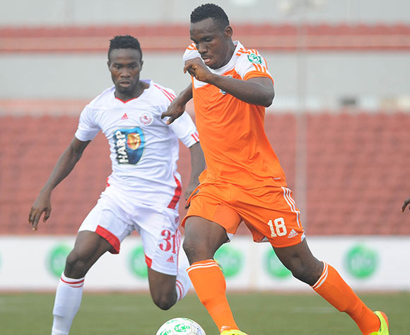 Kingsley Eduwo of Sunshine Stars is challenged by Lukeman Binuyo of Rangers during the Glo Nigeria Premier League 2014  match between Rangers and Sunshine Stars on April 6, 2014 at Nnamdi Azikiwe Stadium, Enugu, Enugu state
