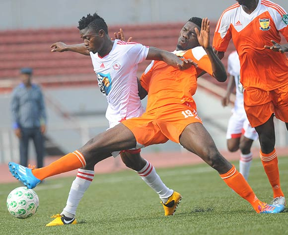 Ikenna Paul of Sunshine Stars tackles Razaq Adegbite of Rangers during the Glo Nigeria Premier League 2014  match between Rangers and Sunshine Stars on April 6, 2014 at Nnamdi Azikiwe Stadium, Enugu, Enugu state