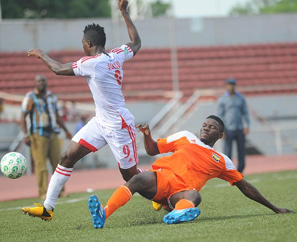 Razaq Adegbite of Rangers is tackled by Ikenna Paul of Sunshine Stars during the Glo Nigeria Premier League 2014  match between Rangers and Sunshine Stars on April 6, 2014 at Nnamdi Azikiwe Stadium, Enugu, Enugu state