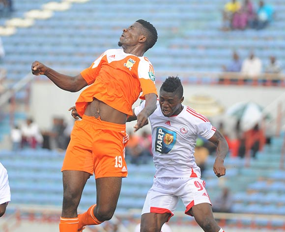 Ikenna Paul of Sunshine Stars in aerial challenge with Razaq Adegbite of Rangers during the Glo Nigeria Premier League 2014  match between Rangers and Sunshine Stars on April 6, 2014 at Nnamdi Azikiwe Stadium, Enugu, Enugu state