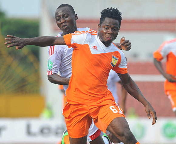 Obinna Nwobodo of Rangers challenges Seun Olulayo of Sunshine Stars during the Glo Nigeria Premier League 2014  match between Rangers and Sunshine Stars on April 6, 2014 at Nnamdi Azikiwe Stadium, Enugu, Enugu state