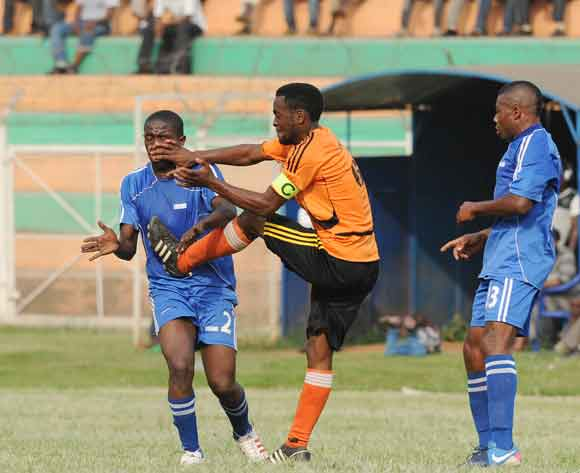 Timothy Musinguzi of Soana FC tackles Ronald Muganga of SC Villa during the 2014 Fufa Super League at Nakivubo Stadium, Kampala on 07 February 2014 ©Ismail Kezaala/BackpagePix