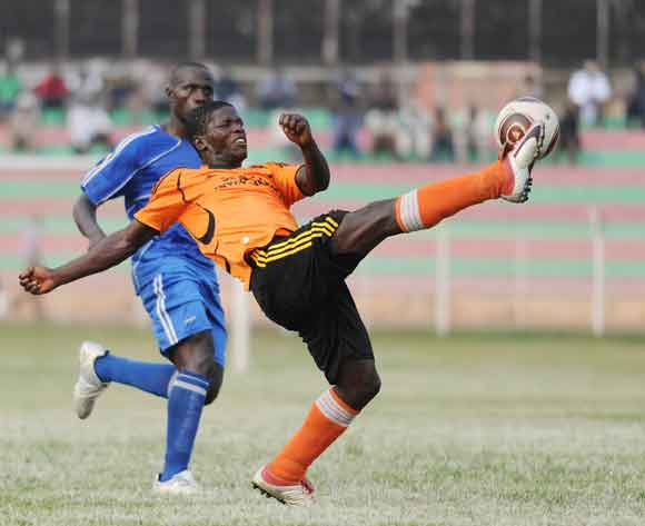 Richard Kigozi of Soana FC kicks away the ball during their 2014 Fufa Super League game against SC Villa at Nakivubo Stadium, Kampala on 07 February 2014 ©Ismail Kezaala/BackpagePix